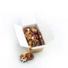 cutie discuri din ciocolată cu lapte cu fructe și diverse nuci